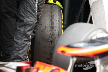McLaren MP4-28 with worn Pirelli tyres
