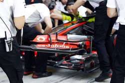 McLaren practice a front wing change in a pit stop