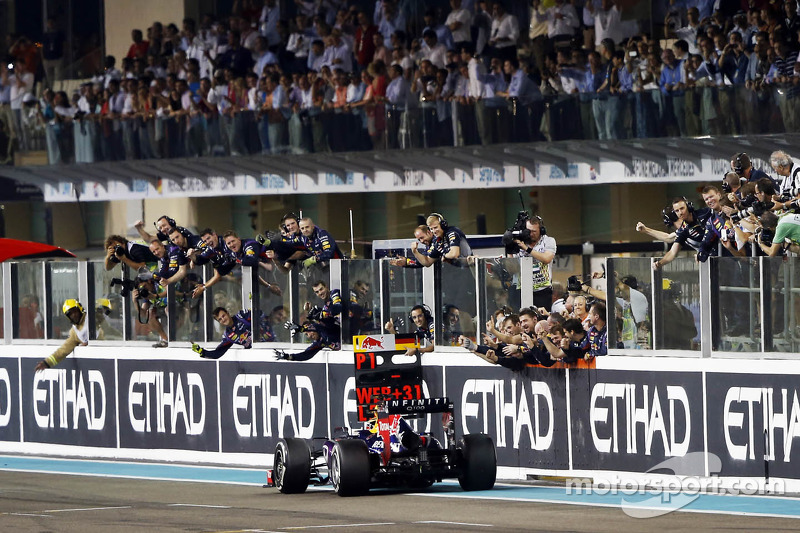 Race winner Sebastian Vettel, Red Bull Racing RB9 celebrates past his team at the end of the race