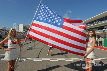 Grid girls with the stars and stripes flag