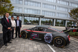 IMSA CEO Ed Bennett, IMSA and International Speedway Corporation (ISC) Chairman Jim France and NASCAR President Mike Helton unveil the addition of IMSA logos to signage outside the eight-story IMC building that is headquarters to IMSA, NASCAR and ISC, pos