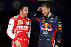 (L to R): Fernando Alonso, Ferrari and pole sitter Sebastian Vettel, Red Bull Racing in parc ferme