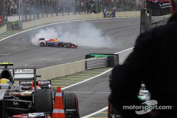 race winner Sebastian Vettel, Red Bull Racing RB9 performs donuts before entering parc ferme