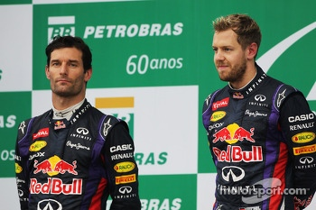 The podium: second place Mark Webber,  Red Bull Racing with team mate, race winner, Sebastian Vettel, Red Bull Racing