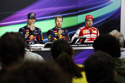 The FIA Press Conference: Mark Webber, Red Bull Racing, second; Sebastian Vettel, Red Bull Racing, race winner; Fernando Alonso, Ferrari, third
