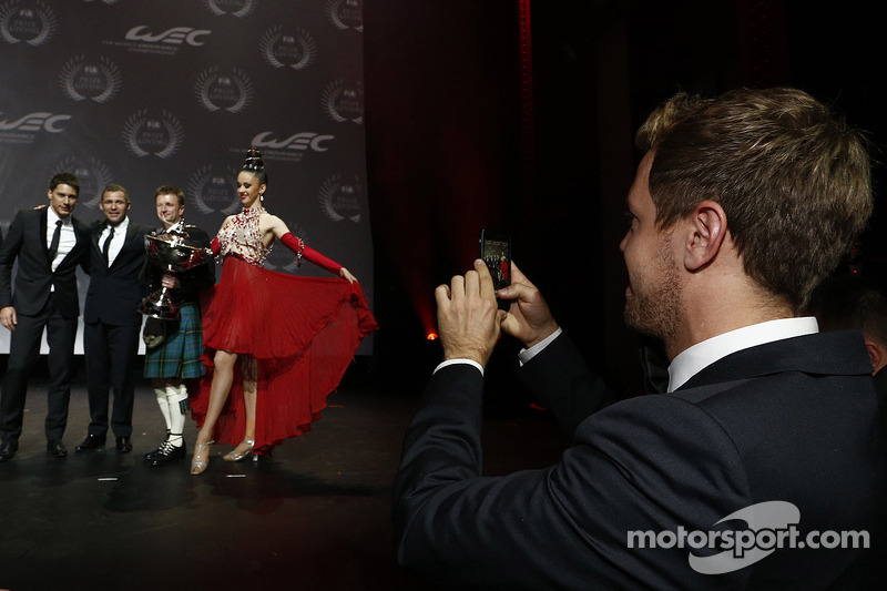 Sebastian Vettel takes a photo of Loic Duval, Tom Kristensen, Allan McNish, Audi Motorsport