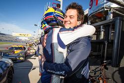 GT pole winner Marc Goossens celebrates with Dominik Farnbacher