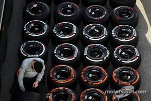 McLaren mechanic prepares Pirelli tyres