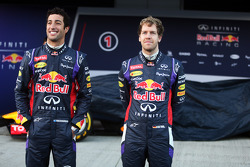 (L to R): Daniel Ricciardo, Red Bull Racing and team mate Sebastian Vettel, Red Bull Racing at the unveiling of the Red Bull Racing RB10