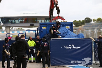 The Scuderia Toro Rosso STR9 of Jean-Eric Vergne, Scuderia Toro Rosso is recovered back to the pits on the back of a truck
