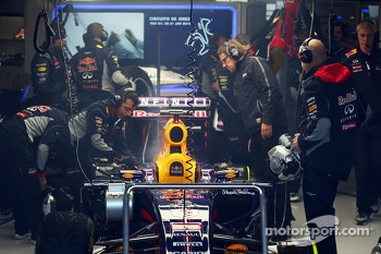 Red Bull Racing RB10 of Sebastian Vettel, Red Bull Racing smoking in the pit garage