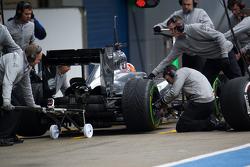 Kevin Magnussen, McLaren MP4-29 practices a pit stop