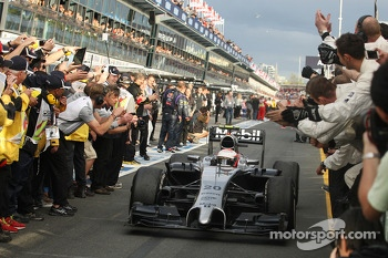 Third placed Kevin Magnussen, McLaren MP4-29 celebrates as he enters parc ferme