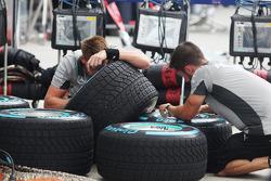 Mercedes AMG F1 mechanics prepare wet Pirelli tyres