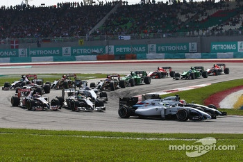 Jenson Button, McLaren MP4-29 and Felipe Massa, Williams FW36 at t sr