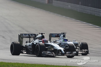 Jenson Button, McLaren MP4-29 and Felipe Massa, Williams FW36 battle for position