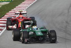Marcus Ericsson, Caterham CT05 leads Kimi Raikkonen, Ferrari F14-T