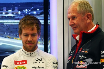 (L to R): Sebastian Vettel, Red Bull Racing with Dr Helmut Marko, Red Bull Motorsport Consultant