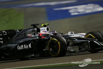 Jenson Button, McLaren MP4-29 and Valtteri Bottas, Williams FW36 battle for position