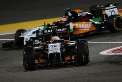 Sergio Perez, Sahara Force India F1 VJM07 leads team mate Nico Rosberg, Mercedes AMG F1 W05