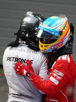 Lewis Hamilton, Mercedes AMG F1 and Fernando Alonso, Ferrari