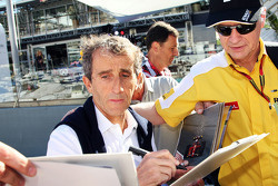 Alain Prost, signs autographs for the fans