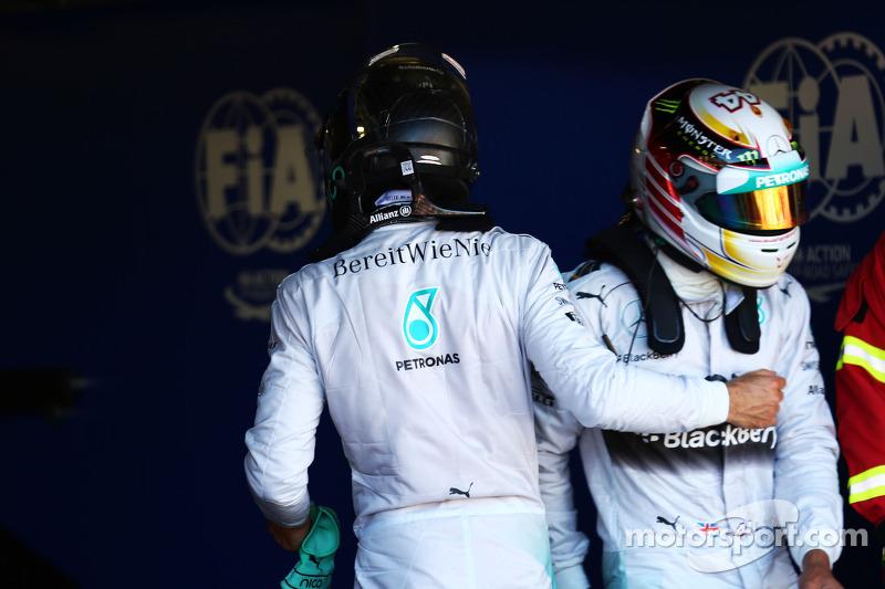 Pole sitter Nico Rosberg, Mercedes AMG F1 with team mate Lewis Hamilton, Mercedes AMG F1 in parc ferme
