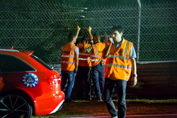 Track workers try to mend the fence but the damage required the session to be stopped