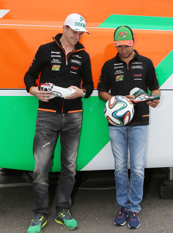 Nico Hulkenberg, Sahara Force India F1 and Sergio Perez, Sahara Force India F1 receive FIFA World Cup themed Alpinestars racing boots