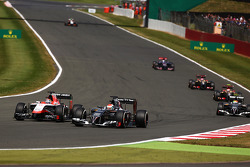 Jules Bianchi, Marussia F1 Team MR03 and ADr. Vijay Malyaian Sutil, Sauber C33 battle for position