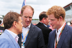 Mark Stewart, (Left) on the grid with HRH Prince Harry, (Right)