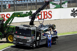 The Mercedes AMG F1 W05 of Lewis Hamilton, Mercedes AMG F1 is is recovered back to the pits on the back of a truck after he crashed out of qualifying