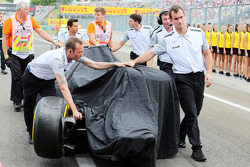 The McLaren MP4-29 of Kevin Magnussen, McLaren is recovered back to the pits after he crashed in qualifying