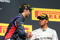 Daniel Ricciardo, Red Bull Racing celebrates on the podium with third placed Lewis Hamilton, Mercedes AMG F1