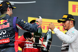Lewis Hamilton, Mercedes AMG F1 and third placed Lewis Hamilton, Mercedes AMG F1 celebrate with the champagne on the podium