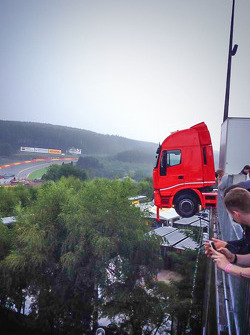 A truck hangs off the Spa paddock as a car sits upside down after falling off the overhang