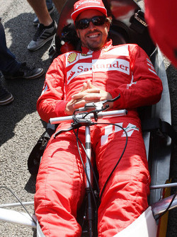 F1: Fernando Alonso, Ferrari drives a car from the Shell Eco Marathon