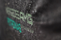 Mercedes AMG F1 logo covered in rain drops