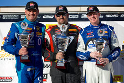 GT-A Winners Podium: Marcelo Hahn (second, left), Michael Mills (first, center), and Alex Welch (third, right)
