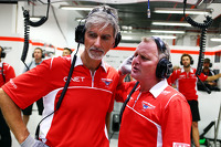 (L to R): Damon Hill, Sky Sports Presenter and Johnny Herbert, Sky Sports F1 Presenter work with the Marussia F1 Team mechanics