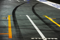 Tyre rubber left in the pits