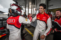 Pole winner Christopher Mies celebrates with Cesar Ramos