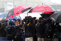 The media in a wet and rainy paddock
