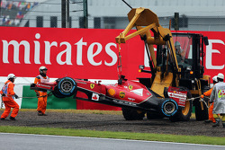 Marshals recover the Ferrari F14-T of race retiree Fernando Alonso, Ferrari with a digger