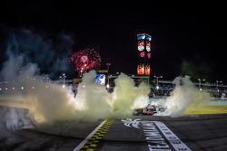 Race winner Darrell Wallace Jr. and Kyle Busch celebrate
