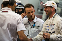 Mark Webber congratulates Neel Jani after his qualifying stint