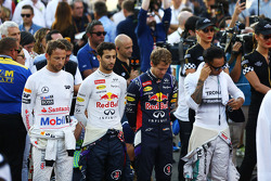 (L to R): Jenson Button, McLaren; Daniel Ricciardo, Red Bull Racing; Sebastian Vettel, Red Bull Racing; and Lewis Hamilton, Mercedes AMG F1 observe the anthem on the grid