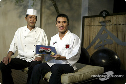 Takuma Sato tries his hand at sushi preparation in Sao Paulo