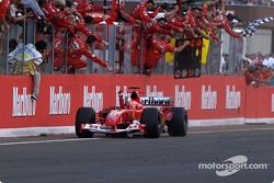 Michael Schumacher takes the checkered flag