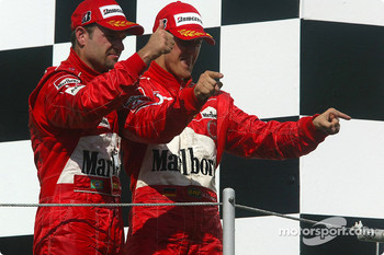 Podium: Rubens Barrichello and Michael Schumacher celebrate